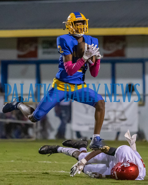 Palatka senior William King (2) leaps to snag his second interception of the night in the second half of their game against Santa Fe Friday night. Fran Ruchalski/Palatka Daily News