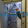 Bread of Life board member Ronald Tomas walks into the walk-in combination refrigerator/freezer donated to the soup kitchen by Lowes as he talks about the community that has rallied to support their efforts. Fran Ruchalski/Palatka Daily News