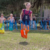 Children hop up and down as they compete in the sack race during the Interlachen Independence Day Celebration. Fran Ruchalski/Palatka Daily News