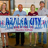 Kari Bates, Wayne McClain, Andrea Conover, and XXX stand behind a banner at Azalea City Brewing Co. as they announce the new brewery's partnership with the Beck 5k Run coming up on June 1st. Fran Ruchalski/Palatka Daily News