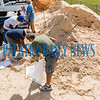 People fill sandbags at the Putnam County Public Works complex in East Palatka Friday morning in advance of Hurricane Dorian's approach. Fran Ruchalski/Palatka Daily News