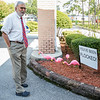 Dr. Anand Kuruvilla comes out to see some of the flock of pink flamingoes outside his office on Monday afternoon after he'd been flocked by Pink Out Putnam. Fran Ruchalski/Palatka Daily News
