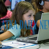 Ten-year-old Kyra Carriere uses coding information to control the movements of on-screen characters at the Generation Mars: Technology Training Camp at the Palatka lbrary on Monday afternoon. Fran Ruchalski/Palatka Daily News