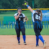 Peniel Baptist Academy's Dylana Lynn snags this popout by Academy at the Lakes' Jessica Mott in front of teammate and second baseman Kristen Flateau in the fourth inning of Tuesday's game. Mark Blumenthal/Palatka Daily News