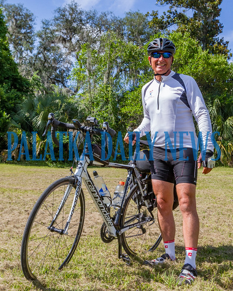 Chris Deringer stands by his bike while talking about his ride to raise money for the Guardian Ad Litem program. His bike and all his gear including his tent, sleeping bag, clothes and other necessities weigh less than 40 lbs. total. Fran Ruchalski/Palatka Daily News