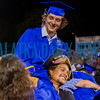 After helping his brother with his studies, Christian Goins happily hoists Gavin Goins on his shoulders to celebrate his receiving his diploma. Fran Ruchalski/Palatka Daily News