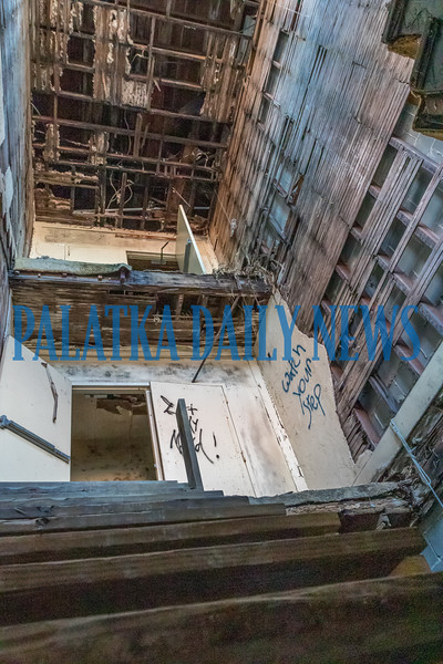 What once was the staircase that went from the first to the third floor of the Hotel James has completely collapsed due to water damage from leaks in the roof. Fran Ruchalski/Palatka Daily News