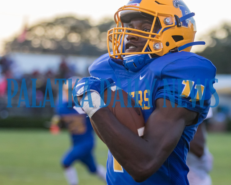 Panthers Wesley Roberts (11) returns the ball down the sidelines in the first half of their game on Friday night against Menendez for the first of his scores. Fran Ruchalski/Palatka Daily News