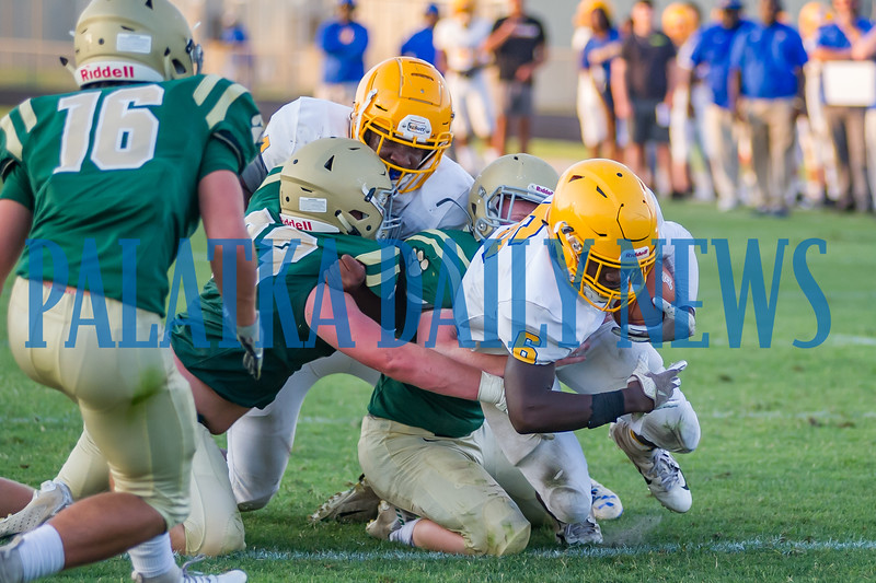 Faizon Sutton (6) drags a couple of Nease players with him as he crosses the goal line in the second quarter for touchdown #2.