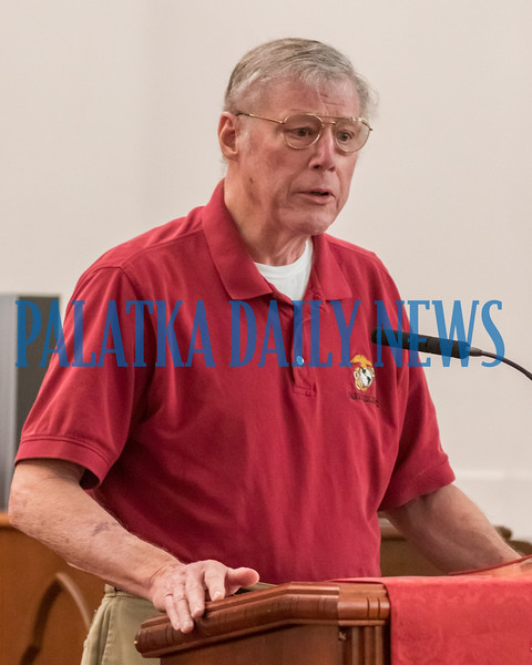 Rev. Dan Smith prays for those who in our military and what they may be facing in the near future. Fran Ruchalski/Palatka Daily News