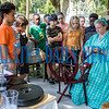 Deb Felts of the Golden Teacups tells visiting fourth-graders about making yarn on a spinning wheel at Occupation Palatka on Friday morning. Fran Ruchalski/Palatka Daily News