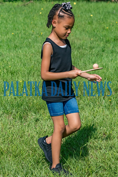 Denaria Williams, 7, a Joseph A. Long Elementary student participates in the egg spoon race during the FFA ag day students at Jenkins Middle School held at their farm for the elementary students on Monday. Fran Ruchalski/Palatka Daily News