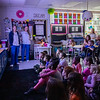 SJRSC nursing students Julia Jettes, left, and Brandi Traxler show third graders at Kelley Smith Elementary School a video about the importance of hand washing to combat the spread of germs on Friday morning. Fran Ruchalski/Palatka Daily News