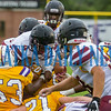 Crescent City sophomore Naykeem Scott (4) jumps over the pile at the goal line in the first quarter for the Raiders first touchdown in the game against Union County on Friday night in a preseason matchup. Fran Ruchalski/Palatka Daily News