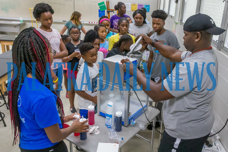Capt. Tobby Williams of the Palatka Police Dept. makes sno-cones for the campers during a break at Camp Higher Ground on Tuesday afternoon. Fran Ruchalski/Palatka Daily News
