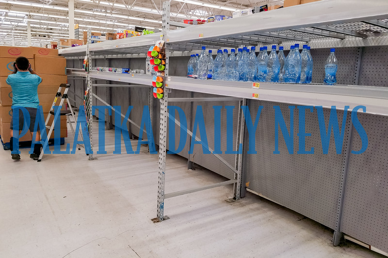 The water aisle at Wal-Mart is almost totally cleaned out as of Thursday morning. Fran Ruchalski/Palatka Daily News