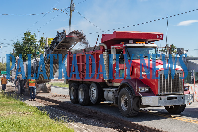 A crew from Halifax Paving strips the asphalt off the 110 N. block of 9th Street Monday morning. Fran Ruchalski/Palatka Daily News