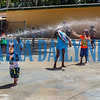 Children at D & G Childcare and Learning Center cool off on Friday morning by running through water sprayed from a hose in the center's yard. Fran Ruchalski/Palatka Daily News
