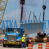 The overhead cranes lift the concrete I-beam from the truck to put it in place on the new SR 17 bridge over Dunn's Creek that is under construction. Fran Ruchalski/Palatka Daily News