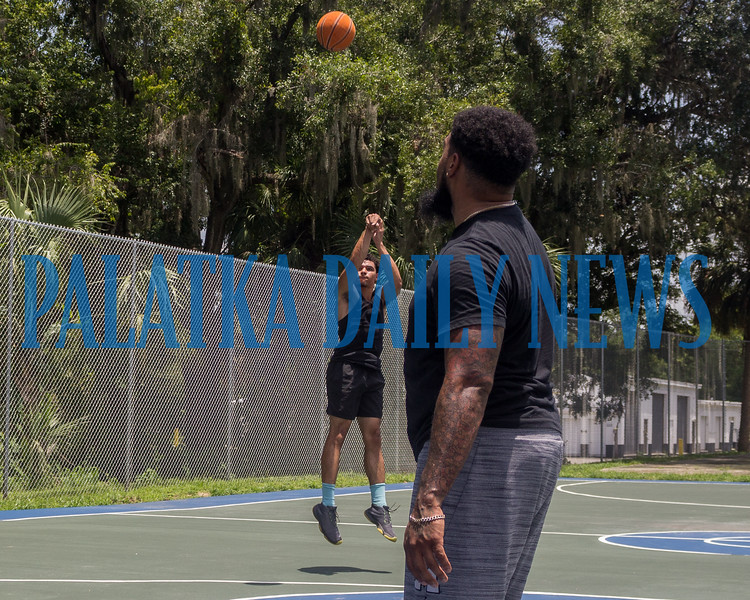 While most folks were hibernating in their air conditioning to beat the heat, Chance Ward pops a shot in a game with his brother Anthony Ward at the newly-resurfaced basketball courts on 14th Street off Crill Avenue on Monday afternoon. Fran Ruchalski/Palatka Daily News