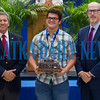 Winner of the Robert W. Webb Award of Excellence Justin Darcey looks over at his parents as he stands with his trophy with school superintendent Rick Surrency and Douglas Webb at the Putnam County Top Scholars celebration on Tuesday night. Fran Ruchalski/Palatka Daily News
