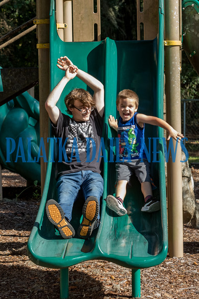 Four-year-old Luke York and Anthony Nacci enjoy a ride down the sliding board together at the playground at Francis Sports Complex on Tuesday afternoon. Fran Ruchalski/Palatka Daily News