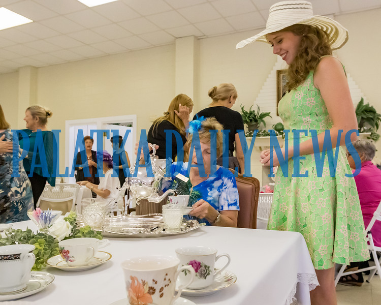 Kay Register pours tea for Kaitlyn Grace at the Annual Membership Tea for the GFWC Woman's Club of Palatka on Thursday afternoon. The tea acquaints new and potential members with all of the things that the ladies club does and it's mission to be of service to the community. Fran Ruchalski/Palatka Daily News