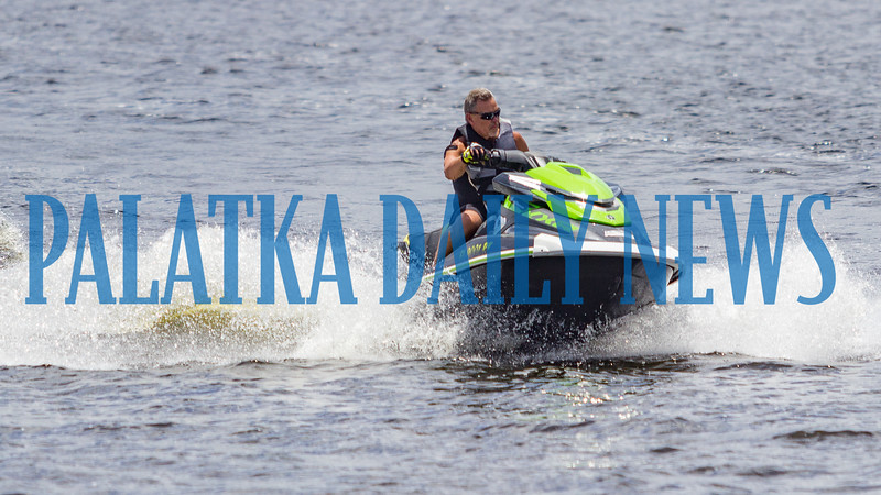 Tony Seago of Green Cove Springs rides his jet ski around the riverfront on Friday afternoon. Fran Ruchalski/Palatka Daily News