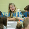 Palatka senior Keslyn Lands, 17, helps her group of Long Elementary fifth-graders to complete lists of possible occupations. Fran Ruchalski/Palatka Daily News