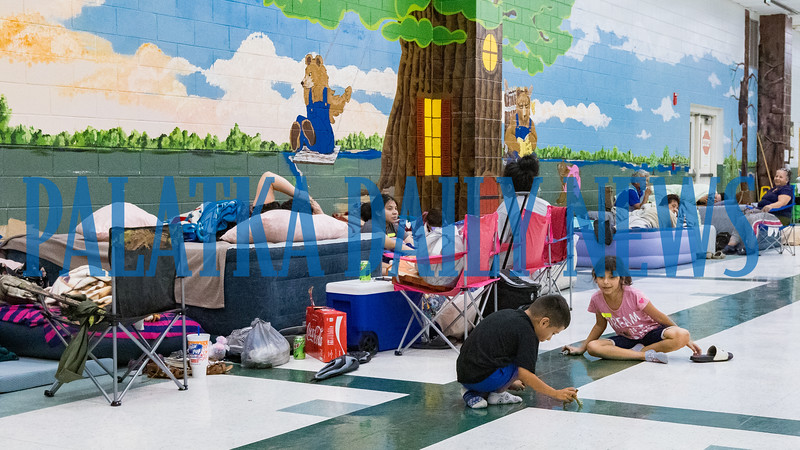 On Monday afternoon, children play together at Browning-Pearce Elementary school which has been opened as a shelter for those without a secure place to wait out Hurricane Dorian. Fran Ruchalski/Palatka Daily News