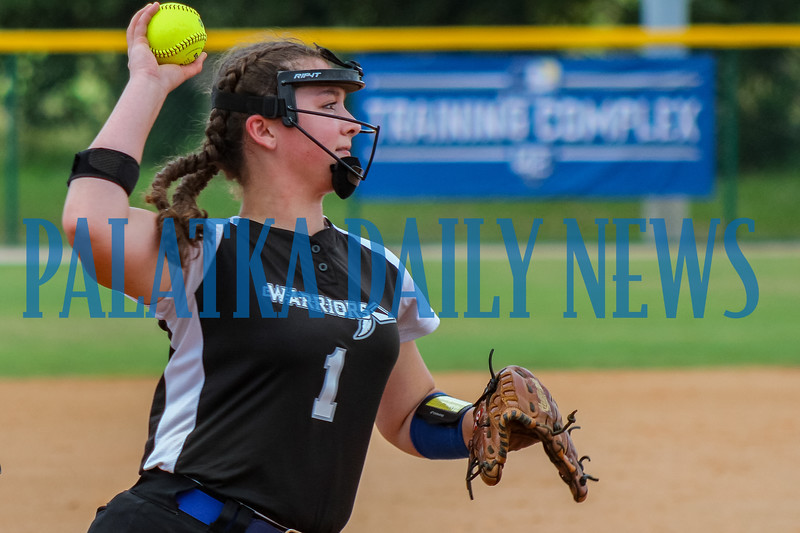 Peniel Baptist Academy third baseman Rylee Romay fields a sacrifice bunt and throws out Aubrey McLoud at first base in the second inning. Mark Blumenthal/Palatka Daily News