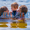 Chloe Polgar, 9, from left, Braysen Abby, 2, and Mike Stoltz enjoy a nice family swim in Lake Stella in Crescent City on Monday afternoon. Fran Ruchalski/Palatka Daily News