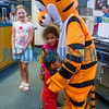 Roselie Oxendine, 6, and Alijah Oxendine, 2, move in for a hug from Tigger at Toddler Fest at the Putnam County Headquarters Library on Saturday morning. About 700 people attended the second annual event this year. Fran Ruchalski/Palatka Daily News