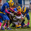 A pack of Panther defenders  converge to upend Santa Fe ball carrier Gerrell Richardson (6) in the second half of their game Friday night. Fran Ruchalski/Palatka Daily News