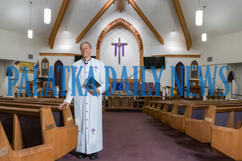 Pastor Karl Flagg stands in the sanctuary of Mount Tabor First Baptist Church on Friday morning. Fran Ruchalski/Palatka Daily News