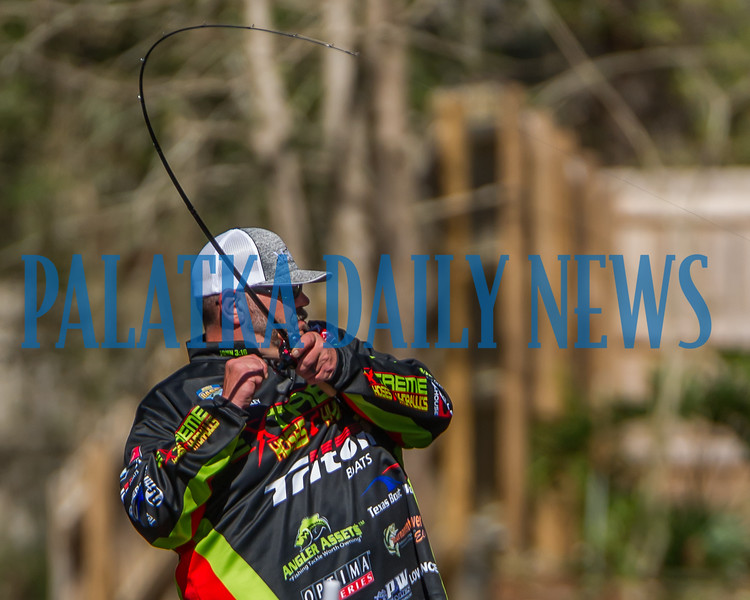 """Frank """"the Tank"""" Talley reels one in as he fishes in a canal on the first day of the Bassmaster Elite tournament on Thursday afternoon. Fran Ruchalski/Palatka Daily News"""