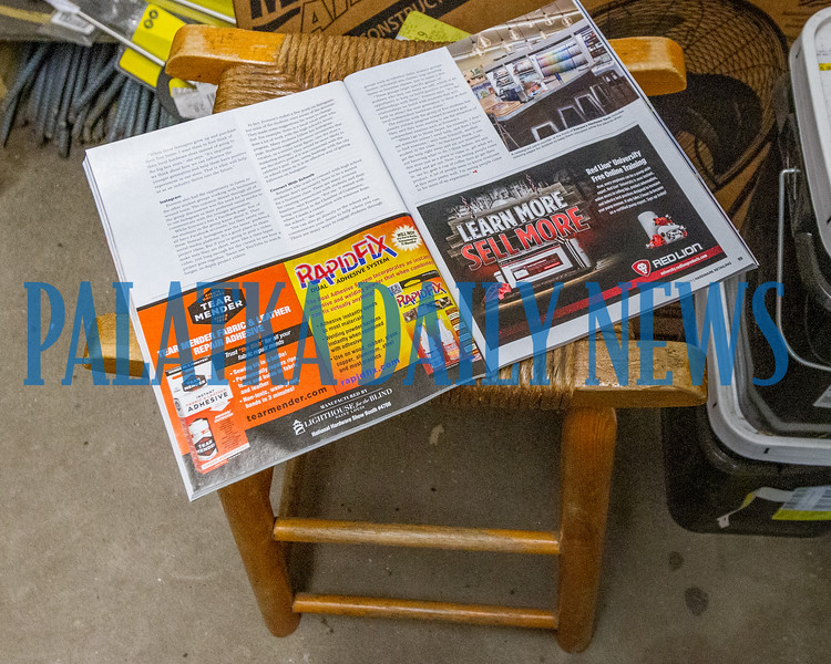 Regular customers of Hills Hardware knew that they could usually find Rodney Sheffield on this stool right by the fishing tackle. The stool and the magazine he was reading remains where he left them. Fran Ruchalski/Palatka Daily News