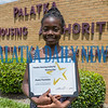 Jhane Fountain, 11, center holds a certificate for her performance in the First Annual FAHRO (Florida Association of Housing and Redevelopment Organizations) Spelling Bee at Walt Disney World. The Moseley Elementary fifth-grader took third place among students from across the state. Fran Ruchalski/Palatka Daily News