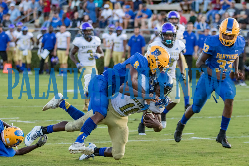 Panthers DeShawn Shaw (8) brings down Menendez quarterback King Benford (11) in the first half of their game on Friday night. Fran Ruchalski/Palatka Daily News