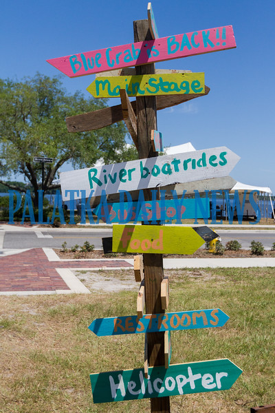 A Key West-style signpost tells you where to go to see all that the Blue Crab Festival has to offer. Fran Ruchalski/Palatka Daily News