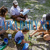 Q. I. Roberts art students Ashley Delarosa, 17, left, works on a sign and Tamecia Epps, 17, draws out a scene on the mailbox for the Palatka Water Works while their art teacher Kala Davis helps her three-year-old son Lincoln with his art project. Fran Ruchalski/Palatka Daily News