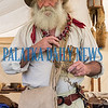 Robert Wilson as trading post proprietor Job Wiggins shows off his bear claw at the Bartram Frolic learning experience for schoolchildren on Tuesday morning. Fran Ruchalski/Palatka Daily News