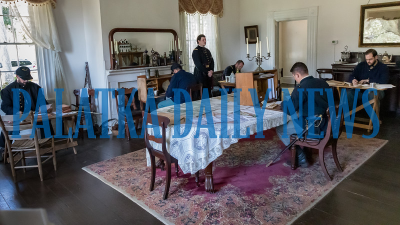 Yankee officers go over their strategy in the dining room of the Bronson-Mulholland House at Occupation Palatka on Saturday morning. Fran Ruchalski/Palatka Daily News