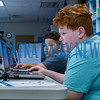Satchell Preston, 11, uses coding information to control the movements of on-screen characters during a practice session as Caleb Moore, 11, looks on at the Generation Mars: Technology Training Camp at the Palatka lbrary on Monday afternoon. Fran Ruchalski/Palatka Daily News