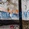 Flames can be seen breaking through the roof of the residence at the fire on Lake Como Drive  in Pomona Park on Tuesday afternoon. Fran Ruchalski/Palatka Daily News