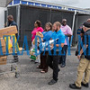 Police and city personnel line up to load more items donated for the Bahamas into a police trailer. Fran Ruchalski/Palatka Daily News