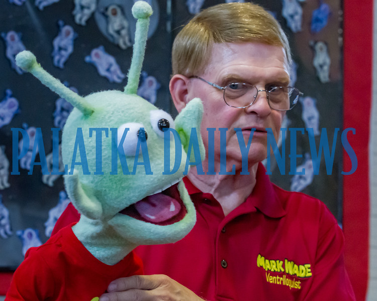Ventriloquist Mark Wade is not too happy with something the alien GLORP said to the crowd during their performance at the Bostwick Library on Friday afternoon. He and his friends will be performing on Saturday at the Crescent City Library and at the ones in Interlachen and Melrose on Wednesday. Fran Ruchalski/Palatka Daily News