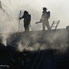 Firefighters from Cal Fire-Butte County and the Chico Fire Department battles smoke and flames in a house Friday, Dec. 30, 2016, on the 800 block of Cleveland Avenue in Chico, California. (Dan Reidel -- Enterprise-Record)