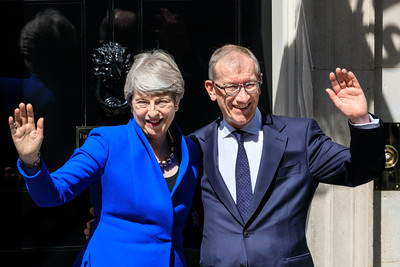 British Prime Minister Theresa May waves with her husband Philip May outside 10 Downing Street before her resignation that day, London, UK