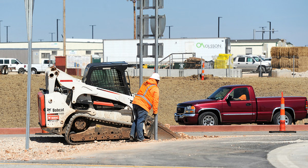 Construction continues Wednesday along a recent road project near I-44 and Hearnes Boulevard.<br /> Globe   Laurie Sisk